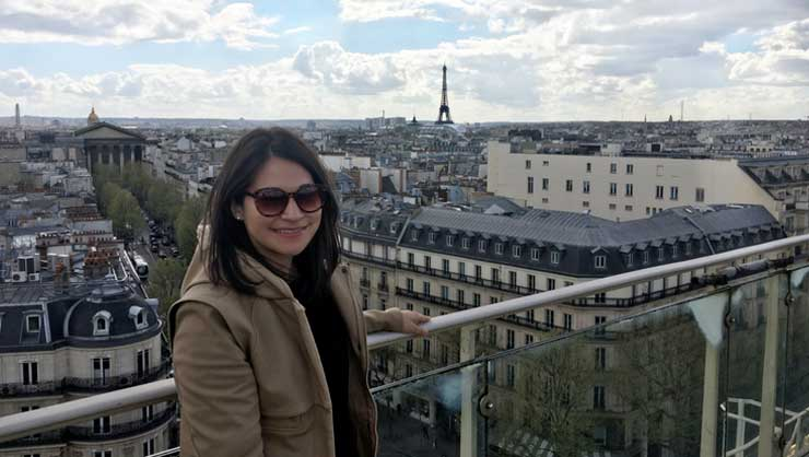 Maia enjoying a view of the Eiffel Tower from afar.