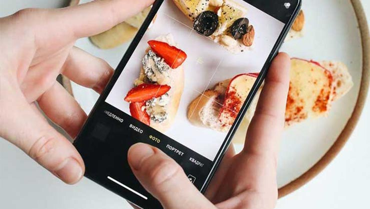 Young person snapping a picture of food for social media