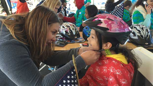 Fairfield County Au Pairs Volunteer at Bicycle Helmet Giveaway