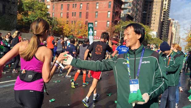 Runners grabbed water while they ran by