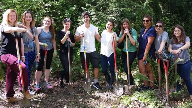 Au pairs celebrated Earth Day by doing conservation work.