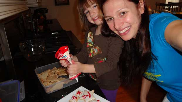 Eva and her host child have fun while baking cookies!