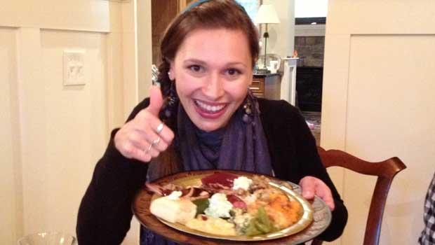 Eva enjoys a traditional Thanksgiving meal.