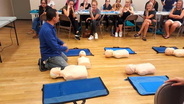 Au pairs get ready to practice on test dummies