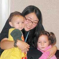 Mayumi hugging kids