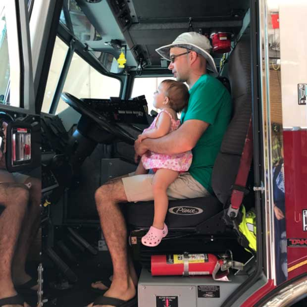 A host dad and his daughter check out the driver's seat of Engine #1.