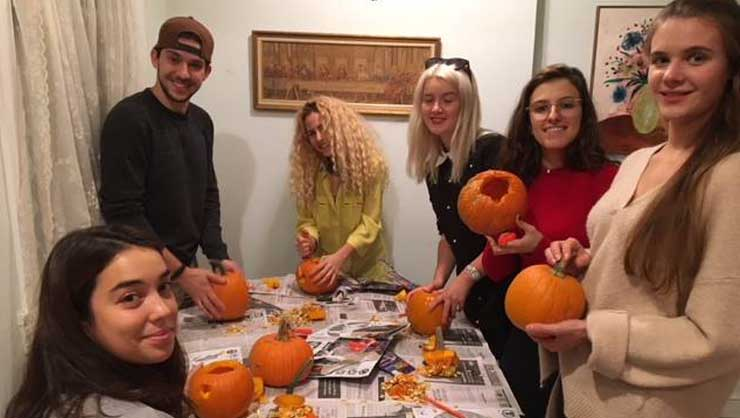 New York au pairs carved pumpkins and celebrated a birthday.