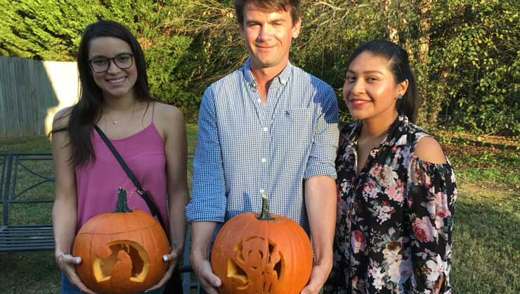 Au pairs in Atlanta carved pumpkins.