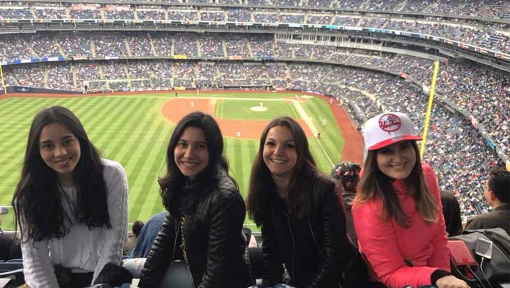 Connecticut au pairs went to a Yankees game.