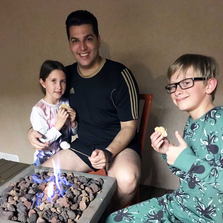 Danillo and his host kids enjoy classic S'mores.