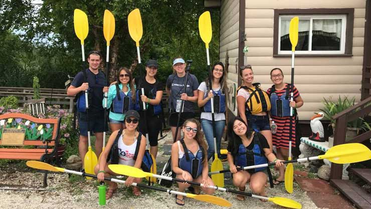Au pairs in Long Island went kayaking on their local bay.