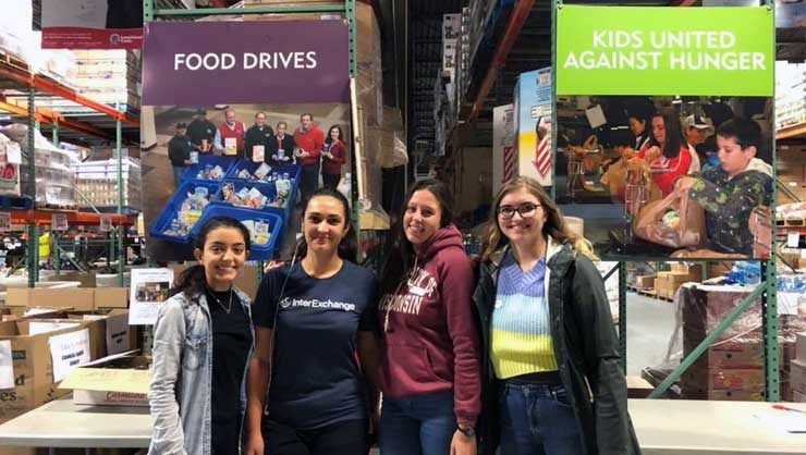 Au pairs in Long Island packed Thanksgiving boxes for families in need.