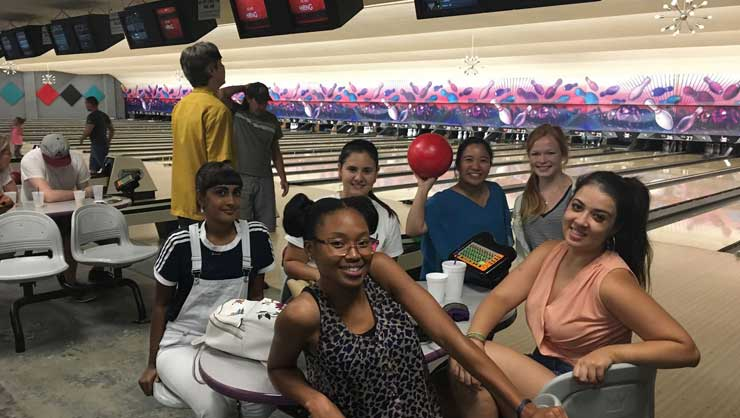 Austin au pairs went bowling.