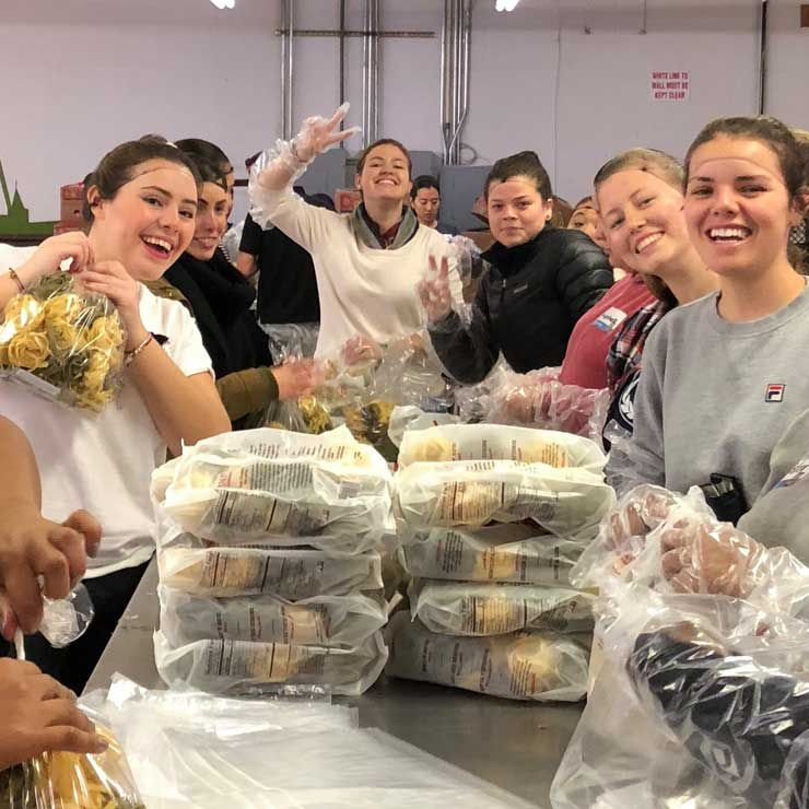 Au pairs in North Carolina packed 5,000 pounds of food for their community.