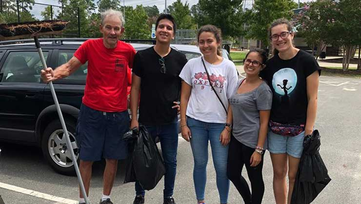 Au pairs in North Carolina cleared trash off a local trail.