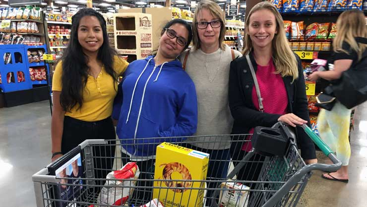 Au pairs and host families from Eastside Seattle bought groceries for charity.