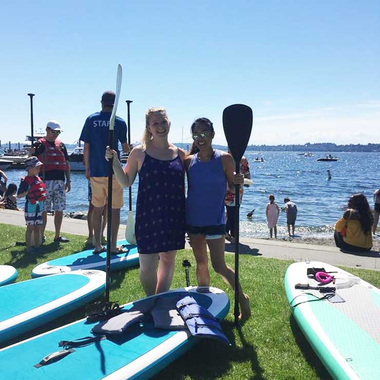 Au pairs in East Seattle went paddleboarding.