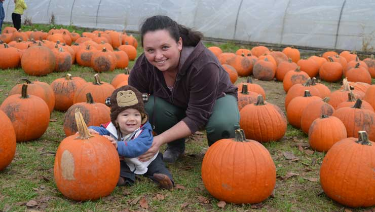 Pumpkin patches are a great place for family photos.