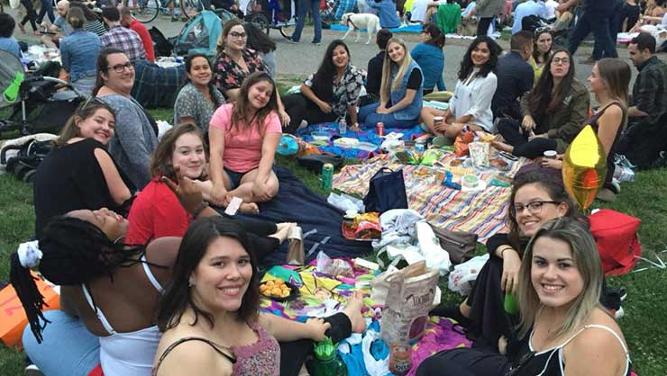 Brooklyn au pairs listened to the New York Philharmonic in the park.