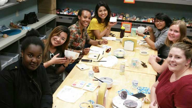 The Seattle au pairs paint pottery.