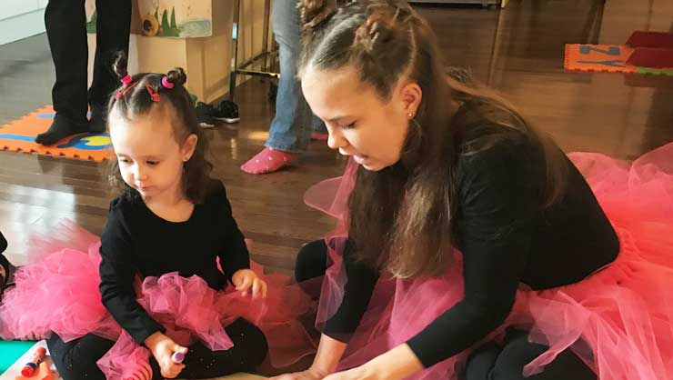 Au Pair Nikoleta and Host Toddler Zoe Sport Matching Costumes