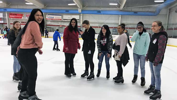 Au pairs in Virginia tried ice skating at the local rink.
