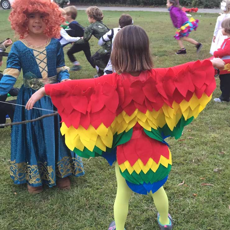 Bianca made a beautiful scarlet macaw costume for her host child, from scratch!