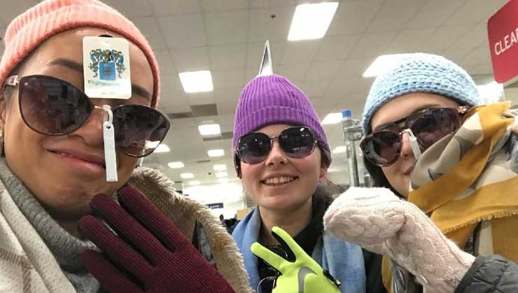 Maryland au pairs bundled up at a mall scavenger hunt.