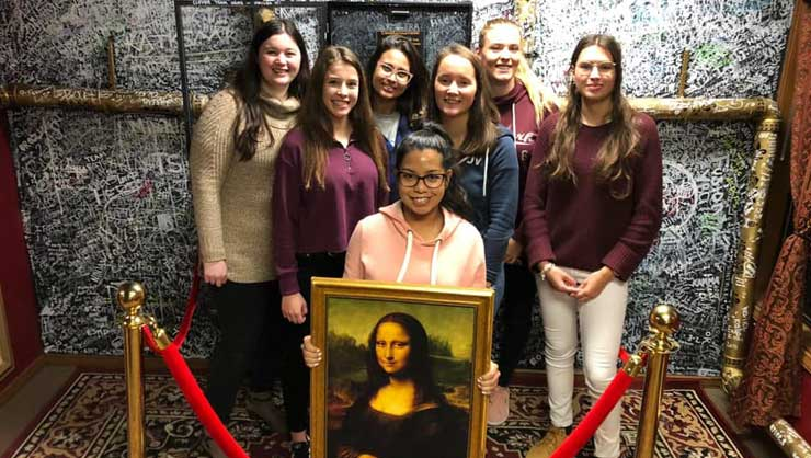 Au pairs in Seattle escaped the winter weather at an escape room.