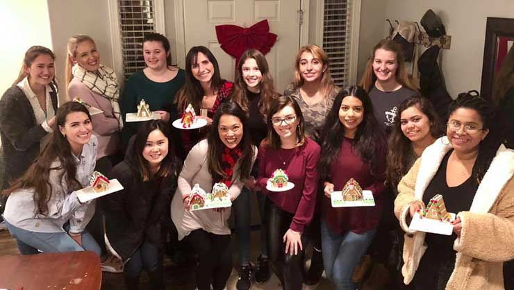 Au pairs in Seattle crafted gingerbread houses.