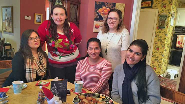 Baltimore au pairs had a multicultural party including Hanukkah traditions, chocolates from England and empanadas.
