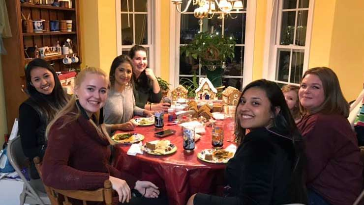 Raleigh au pairs had lots of laughs over international dishes and gingerbread houses.