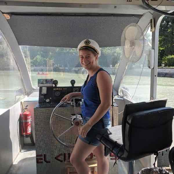 Ainsley T. Playing captain during the riverboat cruise in Aranjuez!