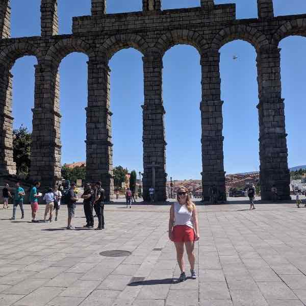 Ainsley T. Standing in front of the Aqueduct of Segovia