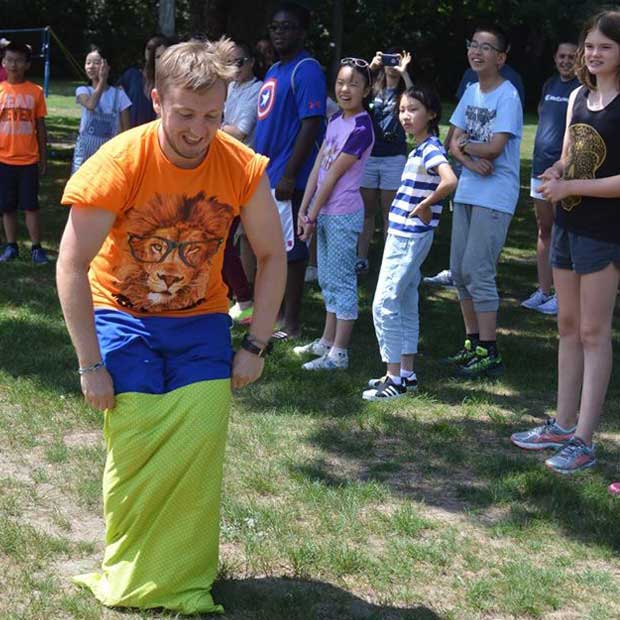 Dennis from the Netherlands demonstrates The Kings Day sack race.