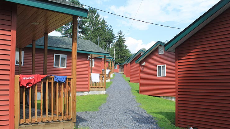 A path with red cabins on both sides