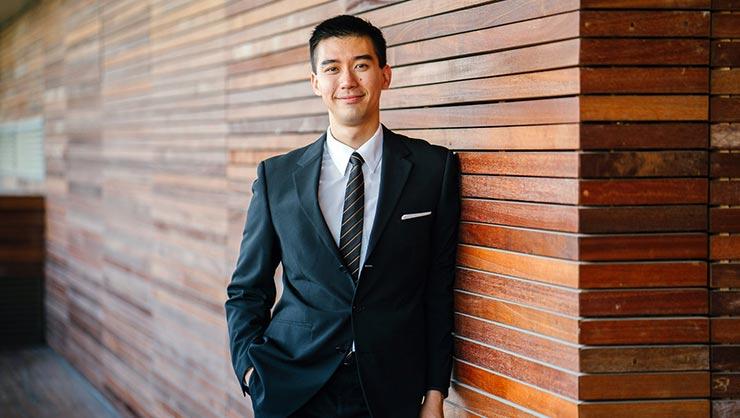 Man in suit smiles