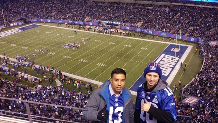 Two men at a New York Giants football game at MetLife Stadium