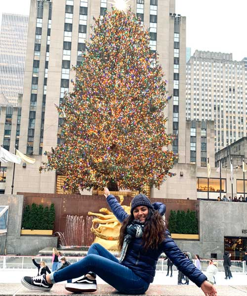 Alice in Rockefeller Center with Christmas Tree