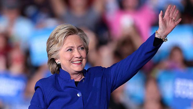 Hillary Clinton waves.