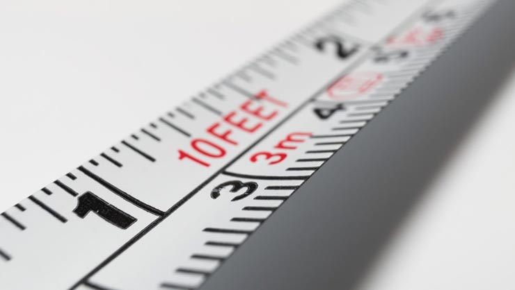 A measuring tape with feet, inches, and meters