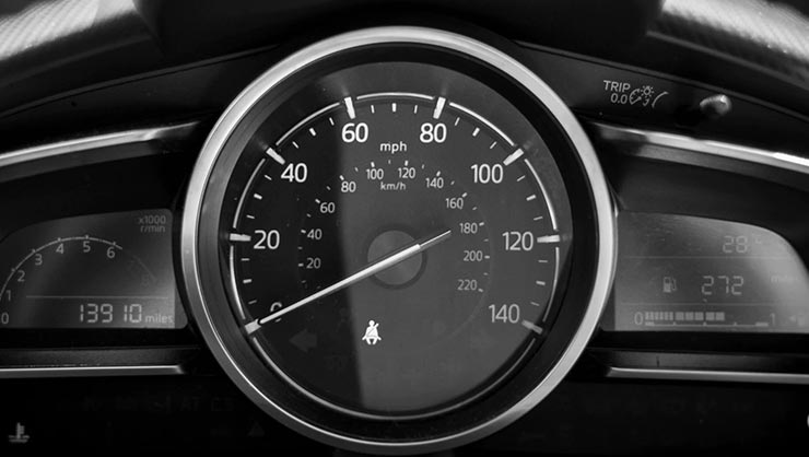 A car speedometer showing miles and kilometers
