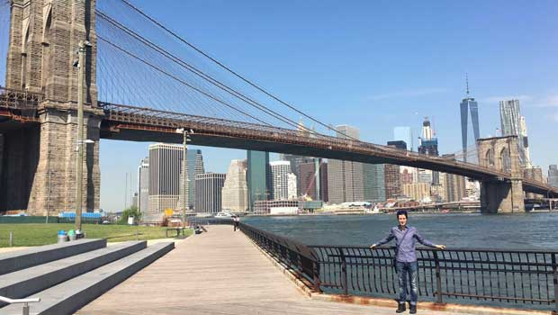 Taking in views of the Brooklyn Bridge and the NYC Skyline.
