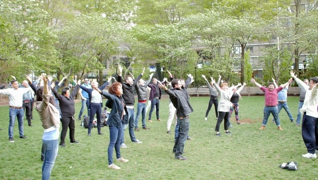 The AFS team relaxes with yoga in the park.