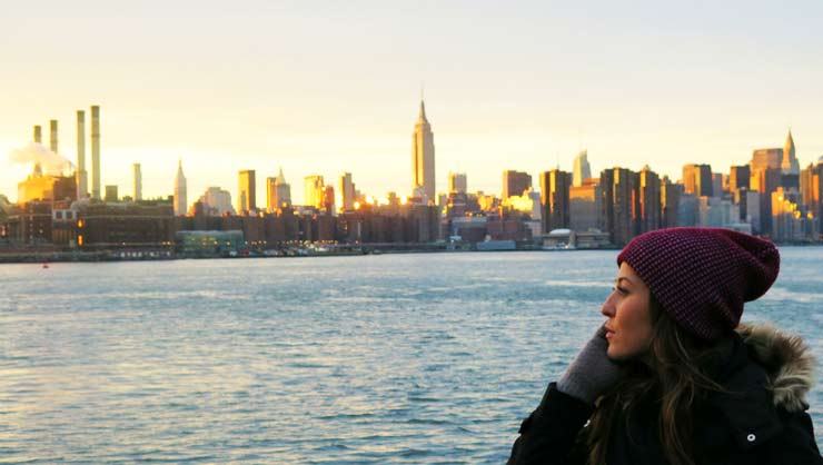 Mirela watches the sunset over New York