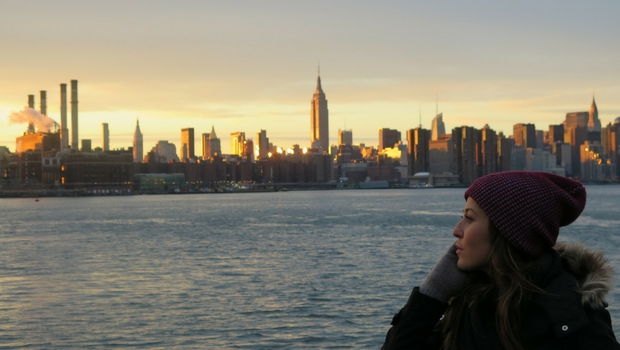 Mirela watches the NYC sunset, reflecting on her time in the U.S.