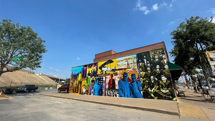 A mural on the side of a building, depicting the Tulsa Race Massacre, in Tulsa, Oklahoma