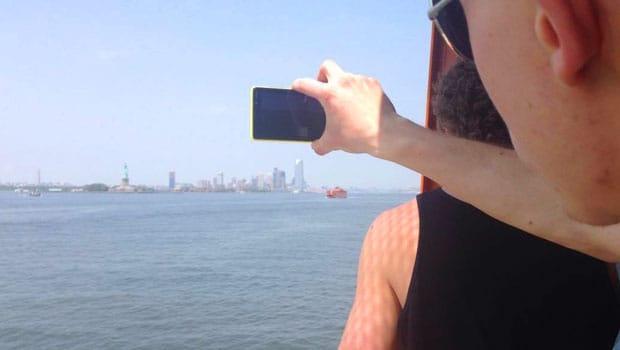 A participant captures a photo of the Statue