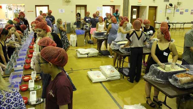 The packaged meals were shipped to Haiti and distributed to local school children.