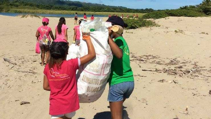The Mariposa girls worked as a team to clean up their beach community.